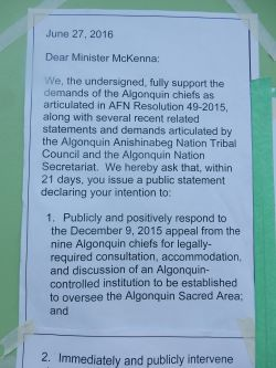 Photo of p1 of letter stuck to outside of McKenna's office, June 27